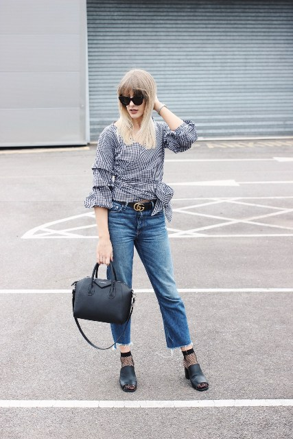 With checked blouse, jeans, black sandals and black bag