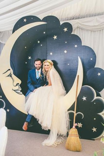 a vintage styled crescent moon with a night sky and stars as a wedding photo booth backdrop