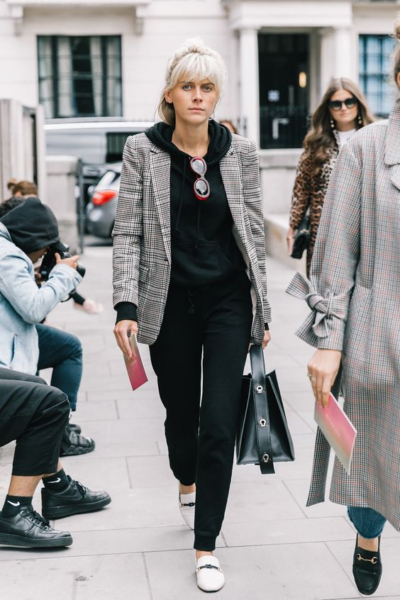 black pants and a hoodie, creamy flats and a checked grey blazer over the outfit