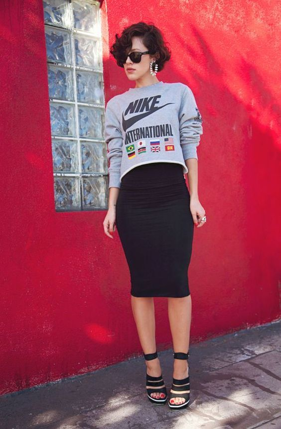 a grey printed cropped sweatshirt, a black knee pencil skirt and black strappy shoes