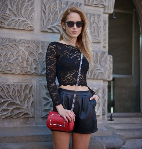 With black shorts and red bag