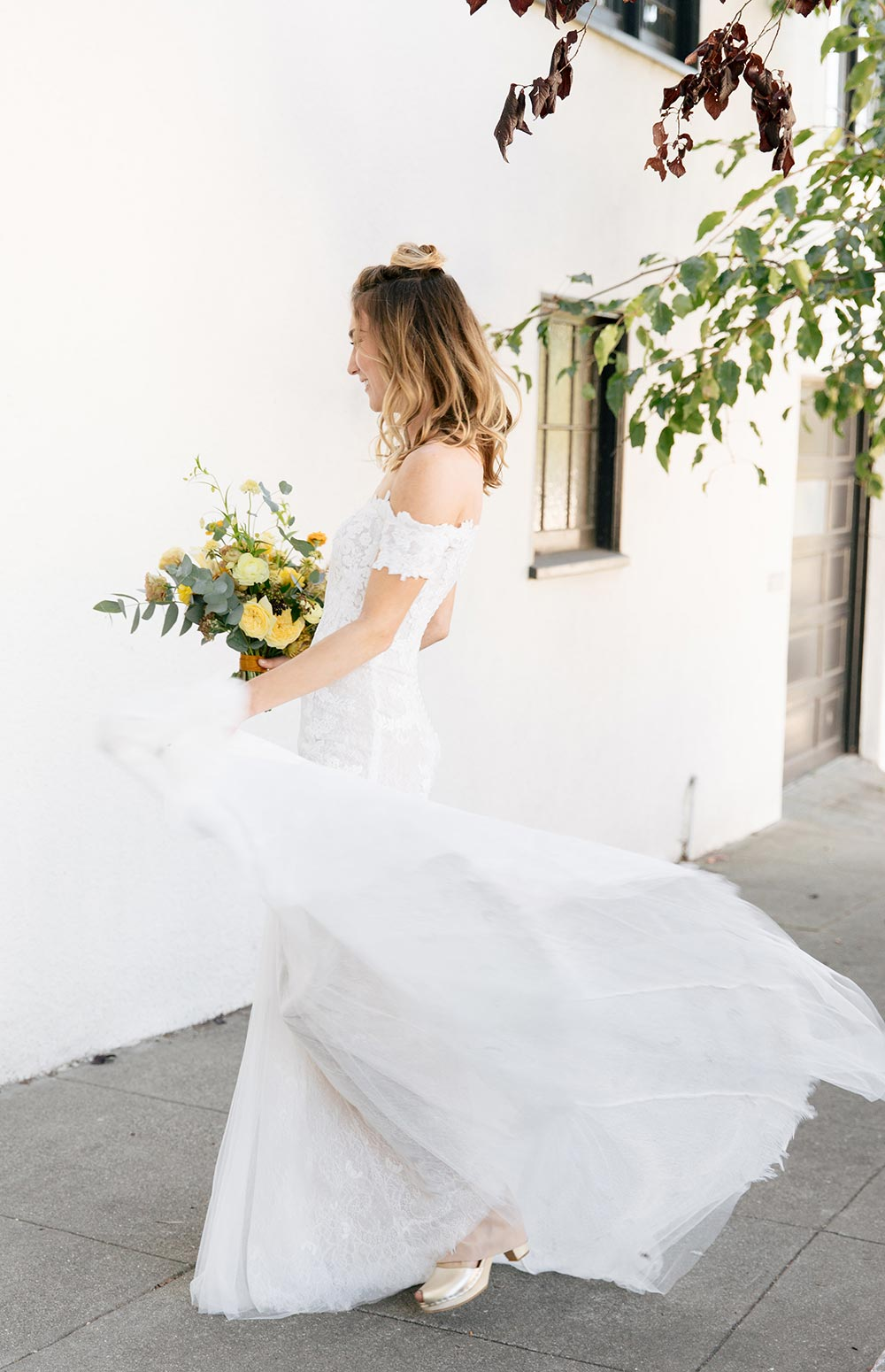 twirly off-the-shoulder lace wedding dress