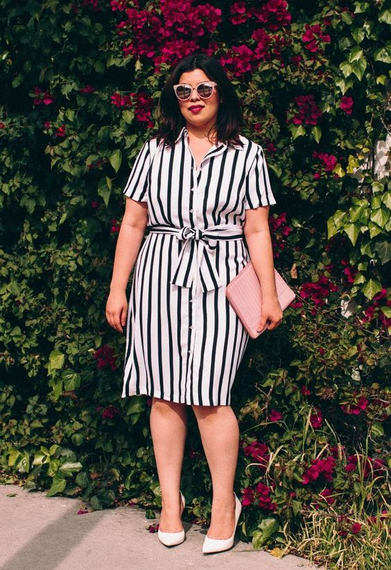 a black and white vertical stripe shirt dress, white heels and a blush clutch for a slight retro feel