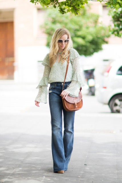 With wide leg jeans, brown leather bag and heels