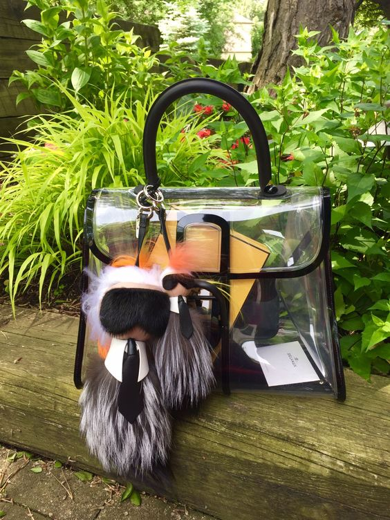 a comfy transparent bag with hangers and black framing for a bold look