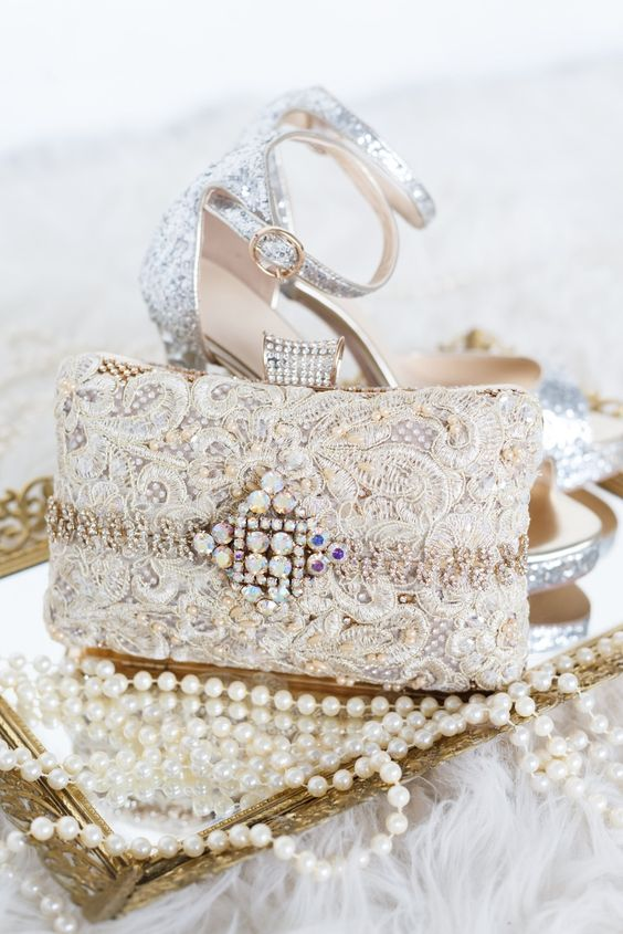 silver glitter shoes and a lace embellished wedding clutch with a lot of bling for a glam feel
