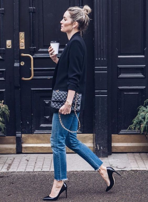 a black jacket, blue raw edge jeans and black heels can be worn to work on a casual Friday