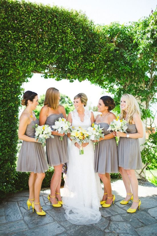 bridesmaids wearing knee dres strapless dresses and neon yellow strappy shoes