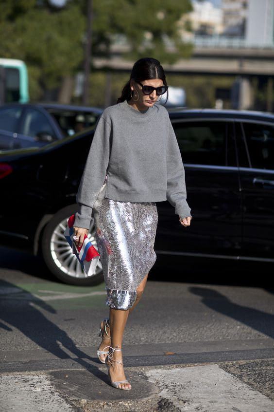 a grey sweatshirt, a silver sequin midi skirt and silver lacing up shoes