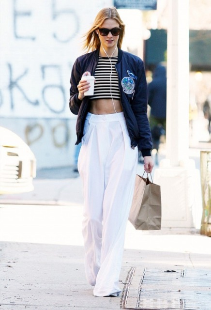 With white trousers and navy blue bomber jacket
