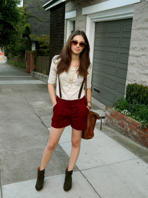 With striped shirt, ankle boots and brown bag