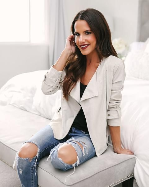 a creamy suede jacket, ripped denim and a black top for a relaxed look