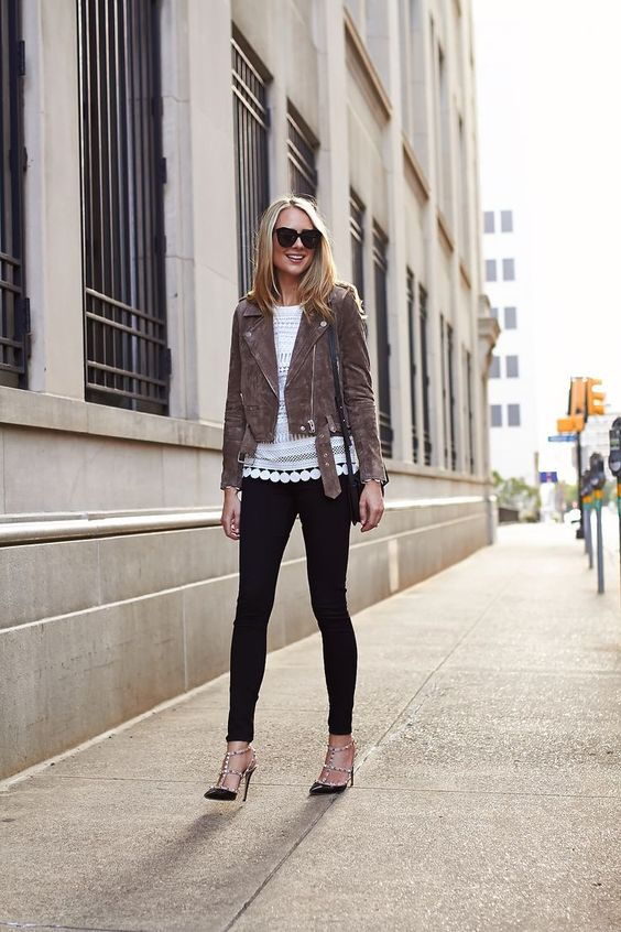 black skinnies, black spiked shoes, a lacey white top and a cropped brown jacket