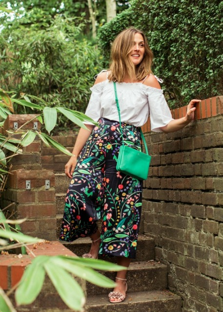 With white off the shoulder shirt, shoes and green bag
