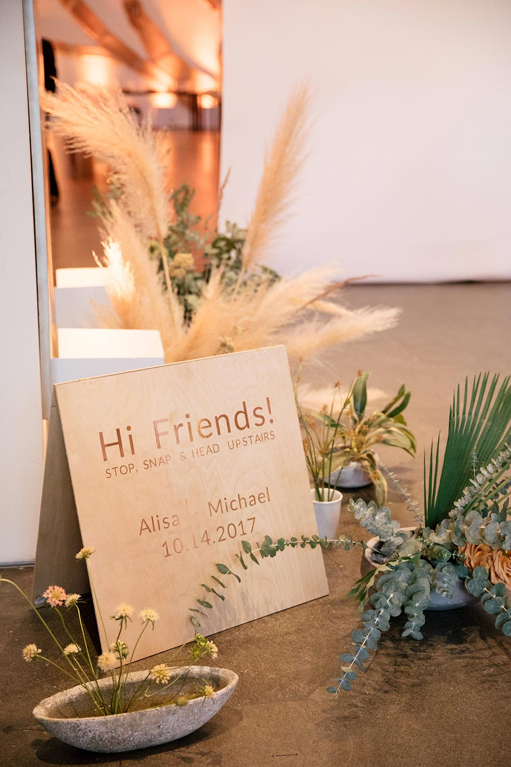 guest welcome signage natural wood and pampas grass