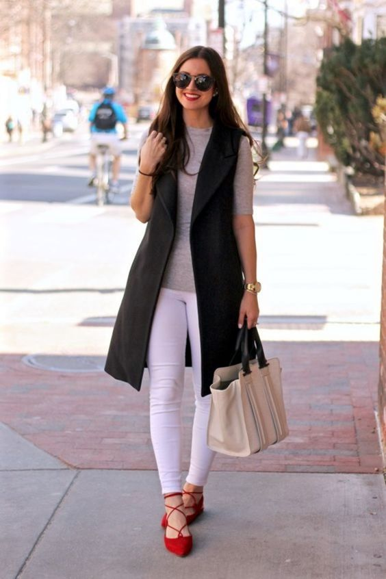 white skinnies, a grey tee, red lace up flats and a black long vest for a a weekend look