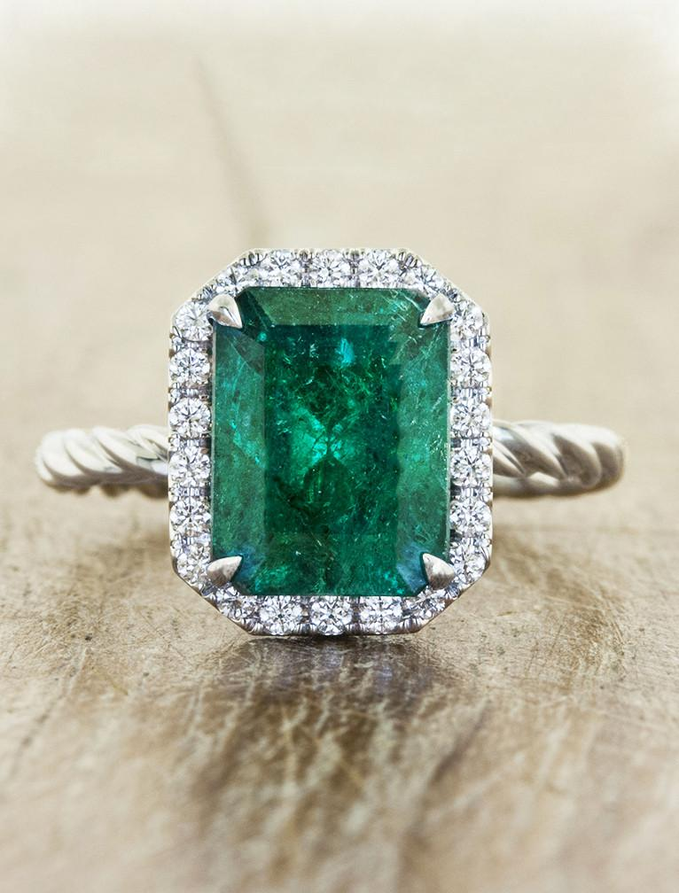 green emerald cut engagement ring with diamond halo