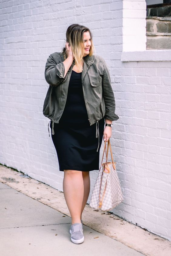 a black knee dress, grey sneakers, an olive green jacket and a bag