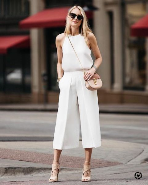an all-white office look with white culottes, a white halter neckline top, nude heels and a crossbody bag, you can change it for a larger one