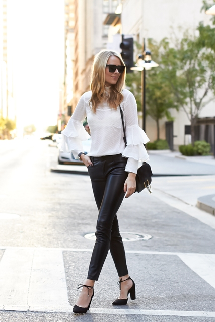 With leather pants, black shoes and black small bag