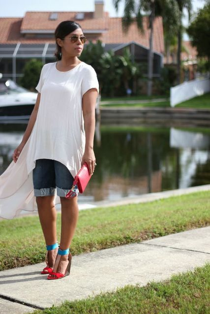 With white loose long t-shirt , colorful sandals and red clutch