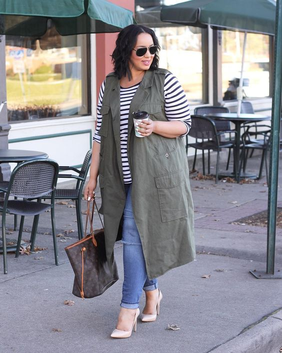 blue skinnies, a striped top, an army green long vest and blush shoes
