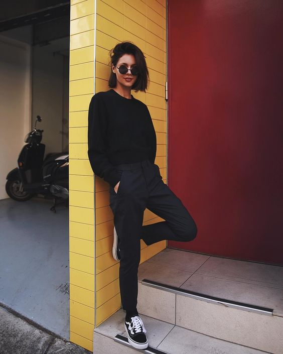 a total black look with Vans, pants and a swetashirt for a bold sport chic look
