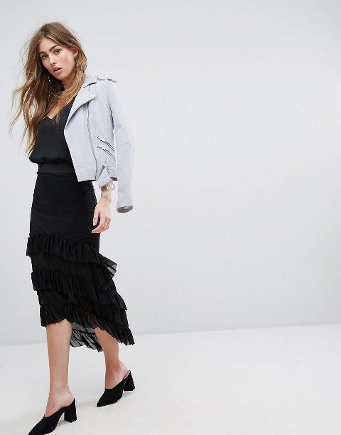With black top, light gray jacket and black mules