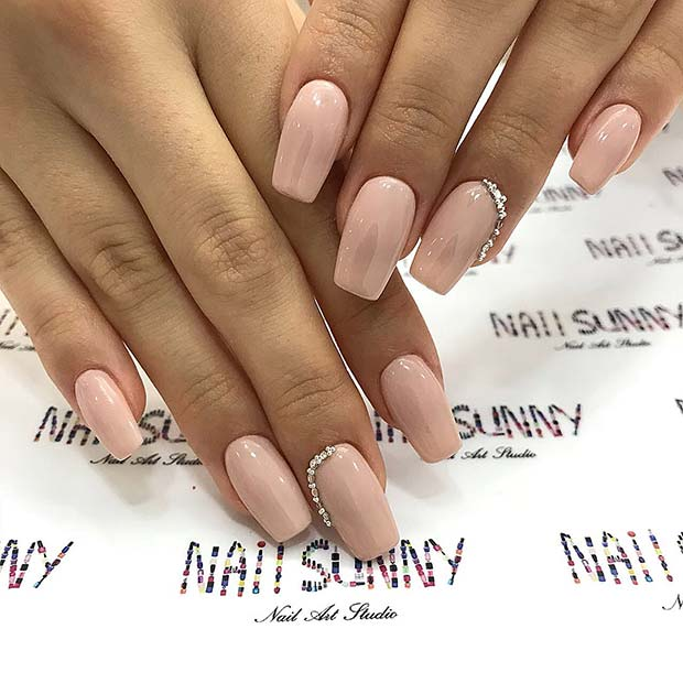 Elegant Nude Nails with Bling
