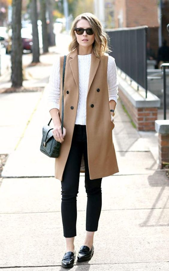 black cropped skinnies, a white long sleeve, a camel long vest and black flats