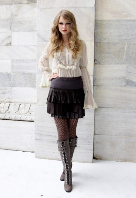 With white ruffle blouse and gray lace up boots