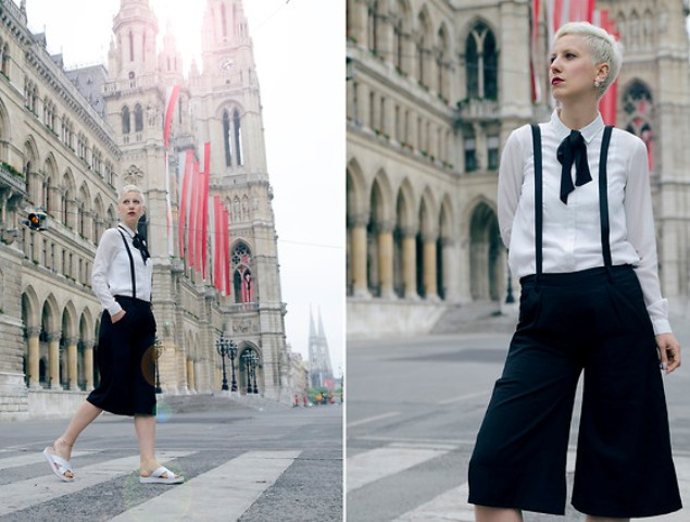 With white button down shirt, white flat sandals and black tie