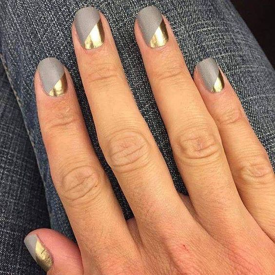 matte grey nails with geometric gold accents for a modern look