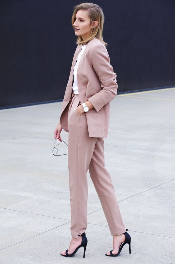 a dusty rose pantsuit, black heels and a white shirt for a girlish work look