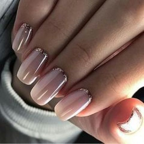 nude nails with a touch of rose glitter for a chic and glam feel at the wedding