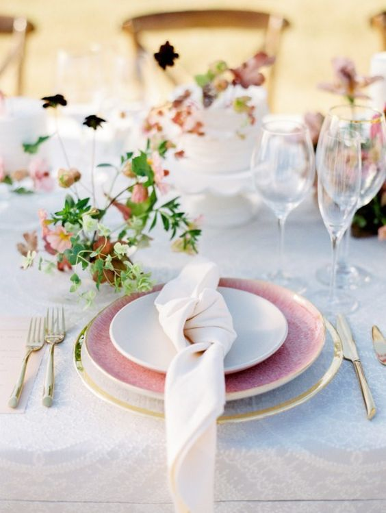 a dreamy garden shower setting with a a sheer platter, a pink plate, gold flatware and delicate greenery and leaves for a summer to fall shower