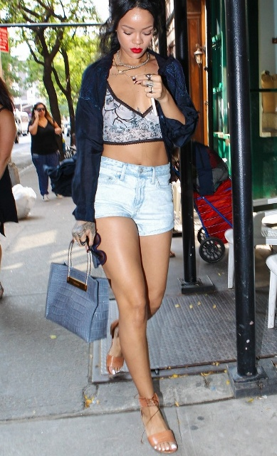 With crop top, denim shorts, blue bag and navy blue jacket