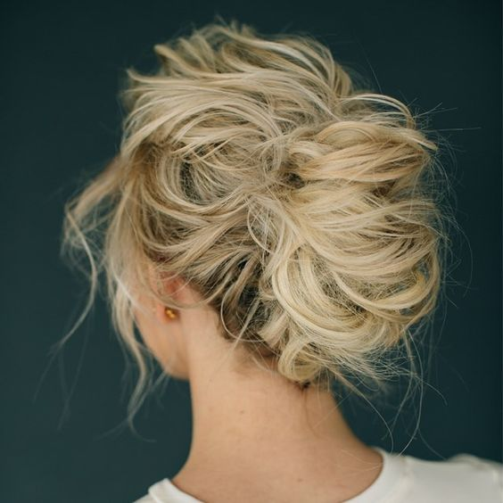 a very messy updo with locks down and much volume for a very casual and boho look