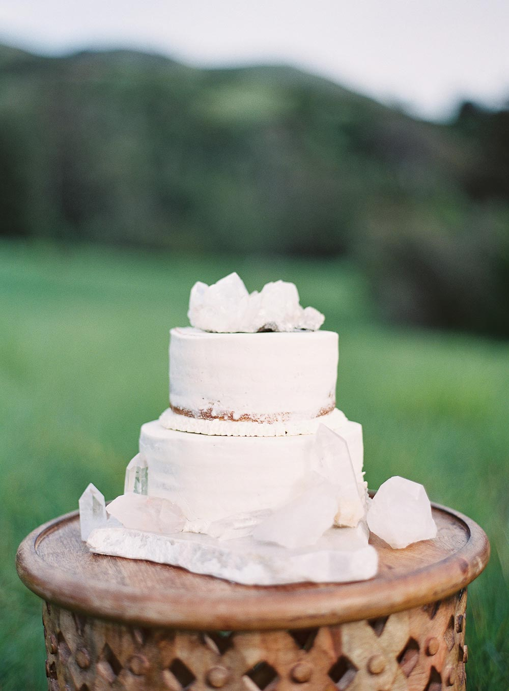 two-tiered wedding cake with natural geodes