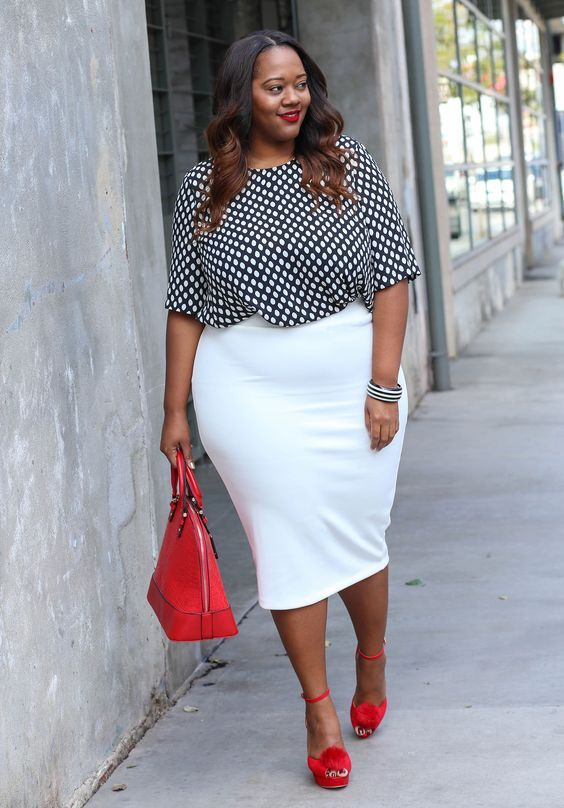 a creamy pencil skirt, a printed top with half sleeves, red pompom shoes and a red bag