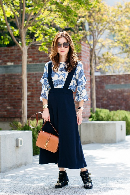 With floral blouse, black ankle boots and brown leather bag