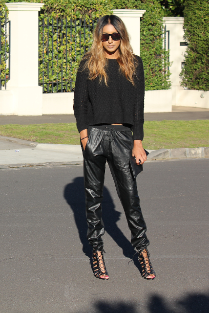 With black loose shirt, lace up shoes and clutch