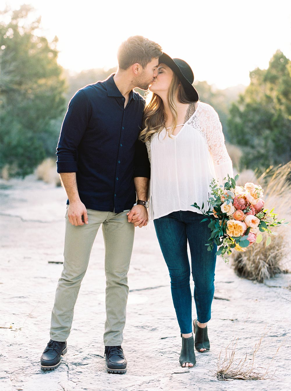 texas engagement session kiss with bouquet