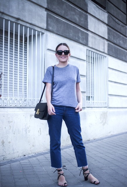 With gray t-shirt, crop jeans and black bag