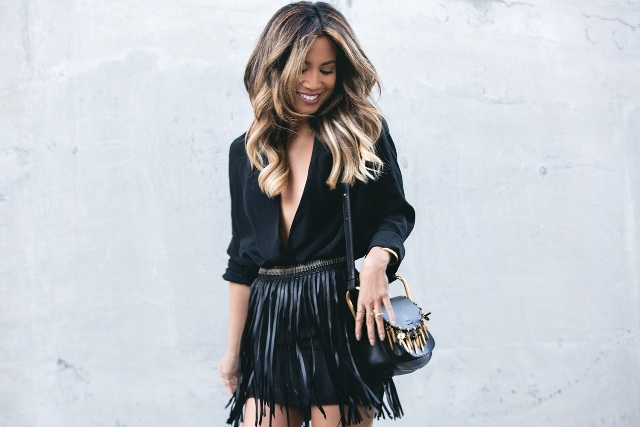 With black wrap blouse, black shorts and bag