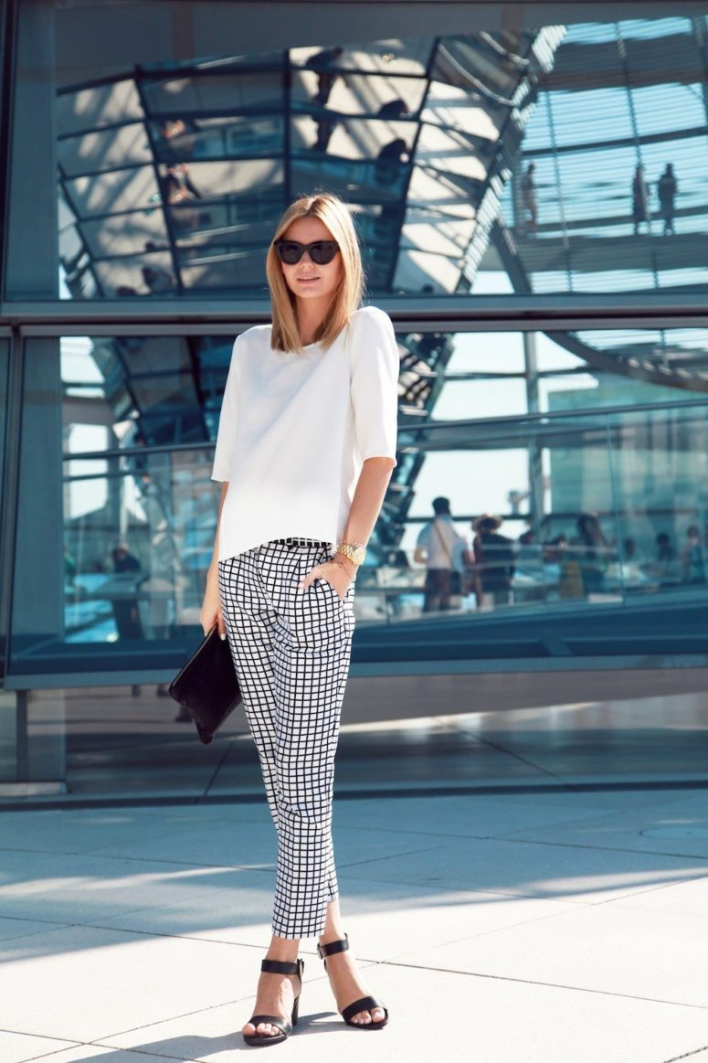 a white tee, black and white windowpane pants, black ankle strap shoes and a clutch