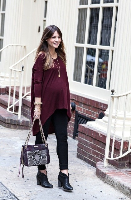 With black leggings, ankle boots and printed bag