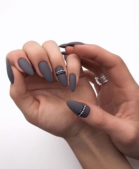 graphite grey matte nails with silver and black beaded stripes for an accent