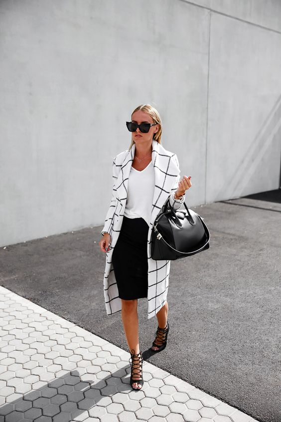 a black pencil skirt, a white tee, black lace up shoes and a black and white windowpane trench
