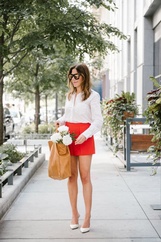 a white button down, white pumps, hot red shorts for a pretty summer look